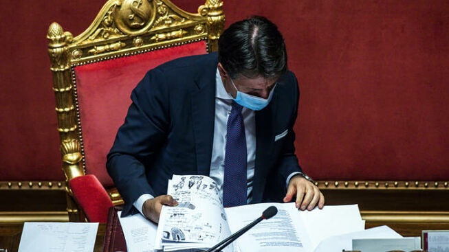 Italian Prime Minister Giuseppe Conte reads notes during communications to the Senate on the epidemiological situation and on any further measures to deal with the emergency of the Coronavirus Covid-19 pandemic, Rome, Italy, 02 November 2020. ANSA / ANGELO CARCONI
